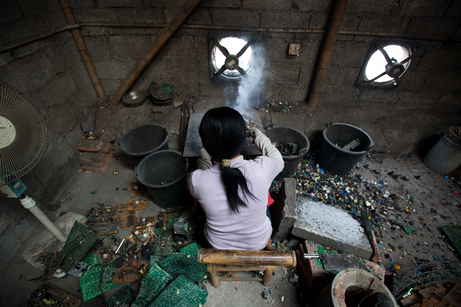 Informal Recycler Melting E-Waste - Collective Responsibility